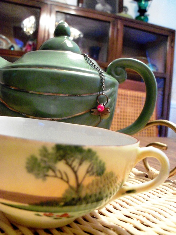 green cup and teapot teaware